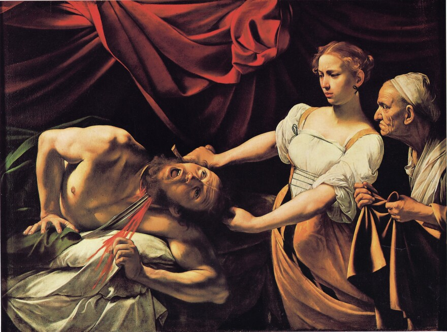 """Hockney says late 16th century Italian painter Caravaggio """"invented Hollywood lighting,"""" as demonstrated (above) in his 1599 work, <em>Judith Beheading Holofernes.</em>"""