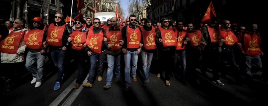Members of the Italian metalworkers trade union Fiom-CGIL march during a protest in Rome on March 9. Thousands of trade unionists protested on a day of strikes against auto giant Fiat and the government's plans to overhaul labor laws to make it easier to fire workers.