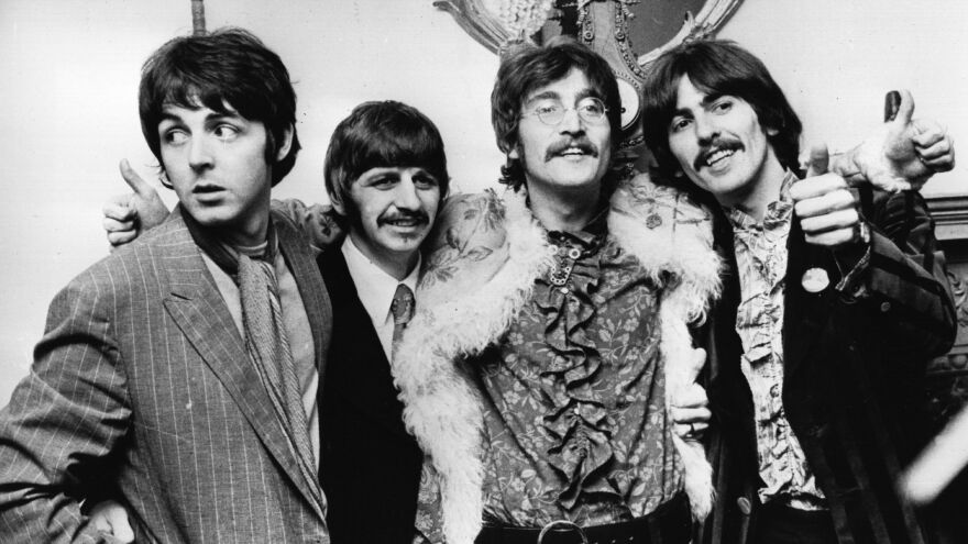 The Beatles celebrate the completion of <em>Sgt. Pepper's Lonely Hearts Club Band</em> at a press conference held at the west London home of their manager Brian Epstein on May 19, 1967.
