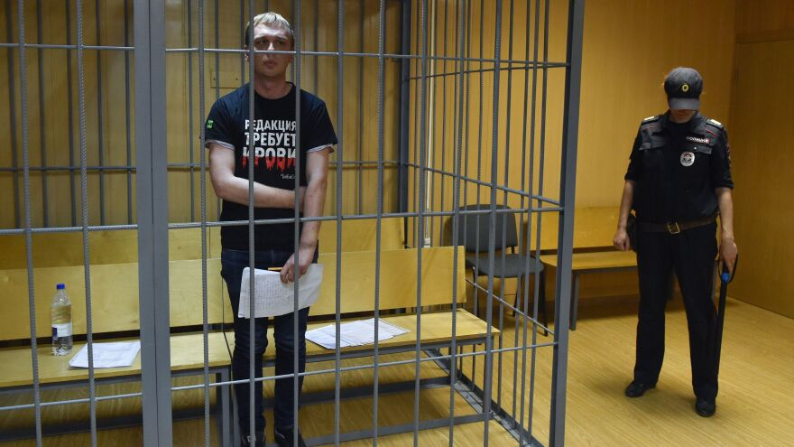 Russian investigative journalist Ivan Golunov was freed days after he was accused of attempting to sell drugs. He's seen here inside the defendants' cage during a court hearing Saturday in Moscow.