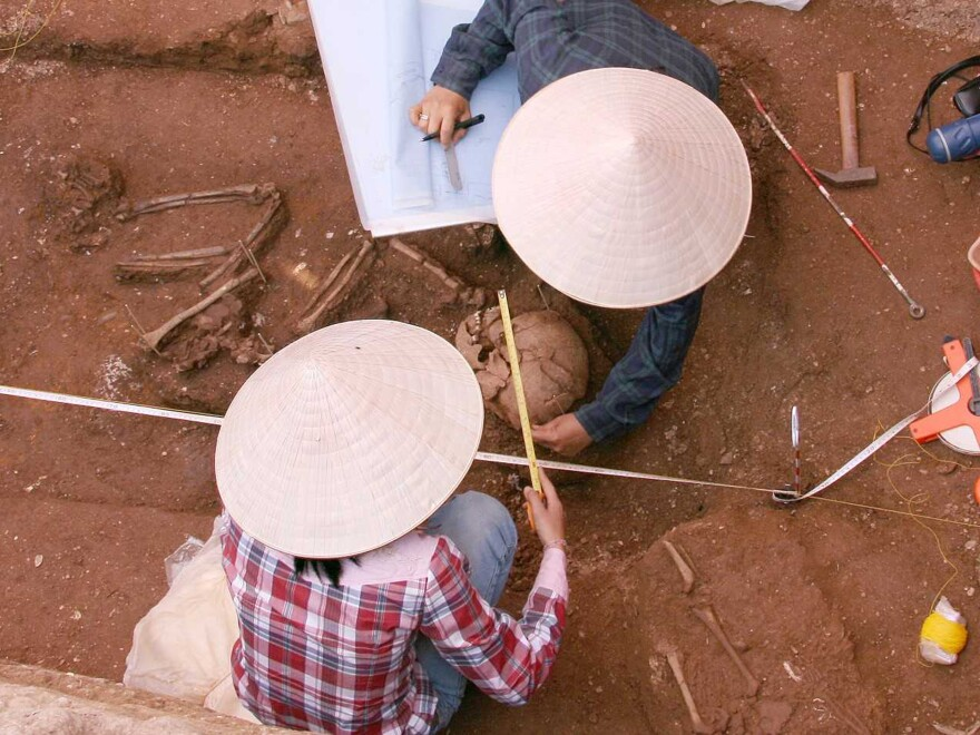 Archaeologists at work on the site in Vietnam where the skeleton now known as Burial 9 was found.