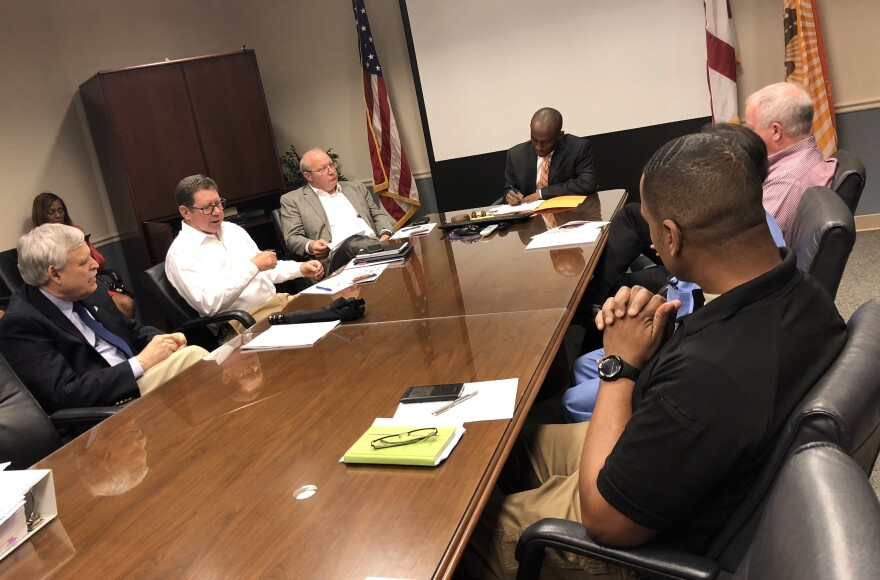 "Councilman Garrett Dennis leads a meeting with other council members, medical examiner's employees, and a Wolfson physician as they talk about ""hit-free zones."""