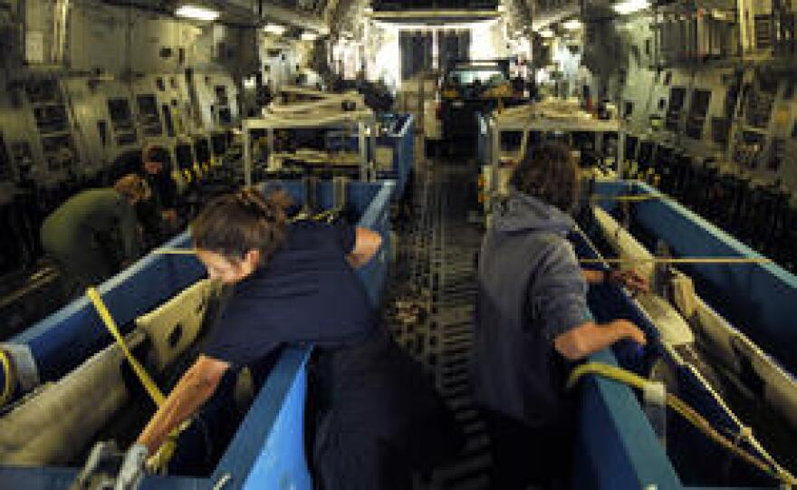 Dolphins that are part of the U.S. Navy's marine mammal program are transported from San Diego to Key West aboard a C-17 aircraft.
