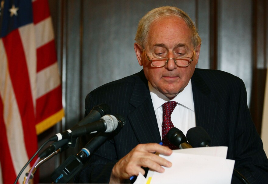 <p>Senate Armed Services Chairman Carl Levin (D-MI), looks at his papers while talking about U.S. companies recieving large tax breaks, during a news conference on Capitol Hill.</p>