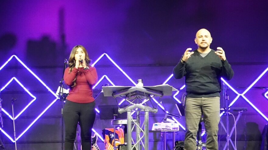 Angel Flores (right), founder and lead pastor of Mosaic Church, delivers the message during the Spanish worship service.