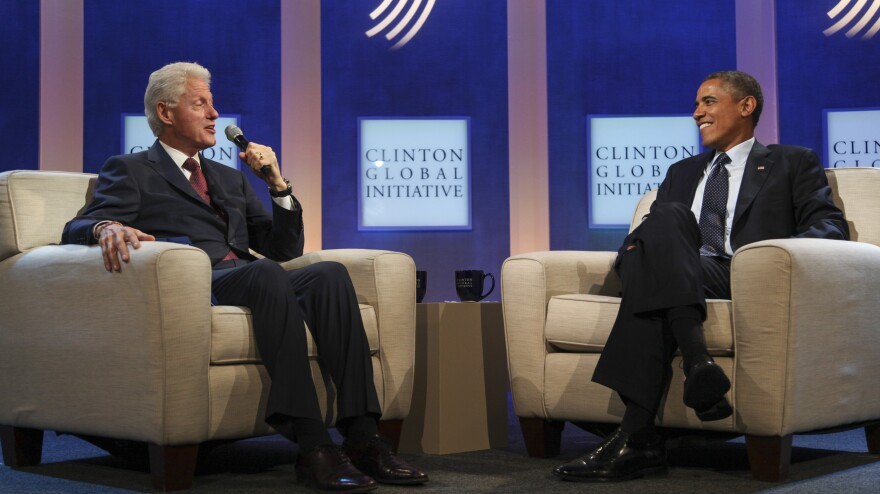 President Obama joins former President Clinton to talk about the health care law, during the annual Clinton Global Initiative meeting Tuesday in New York.