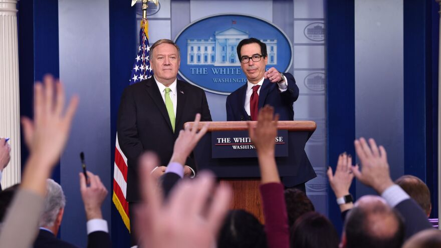 U.S. Secretary of State Mike Pompeo (left) and Treasury Secretary Steve Mnuchin take questions during a news conference Friday. They announced new sanctions against Iran and accused the country of shooting down a Ukrainian passenger jet earlier this week.