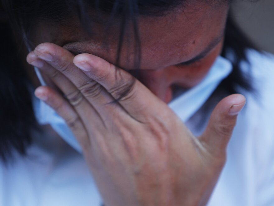 A Nepali woman cries as she participates in a candlelight vigil for victims of last week's earthquake in Kathmandu, Nepal, on Saturday.
