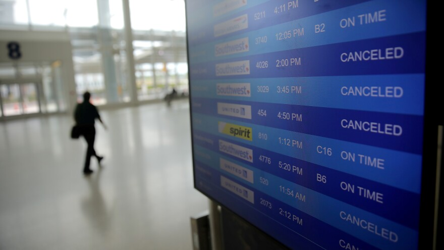 The plunge in demand for air travel during the coronavirus crisis is reflected on an airport screen in New Orleans on April 4.