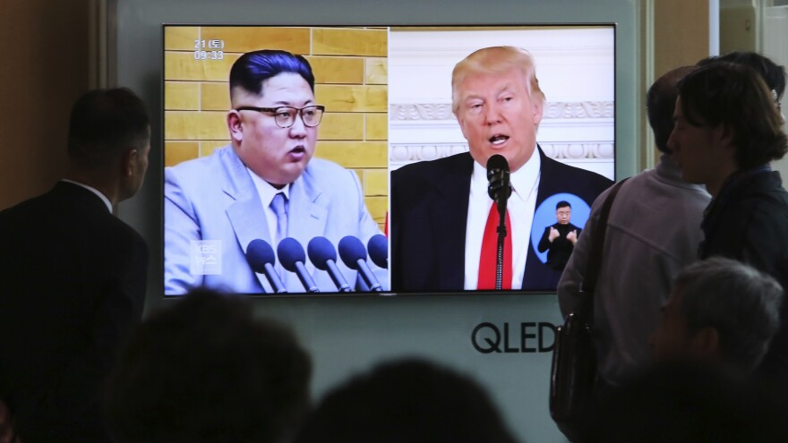 """President Trump tweeted of North Korean leader Kim Jong Un's announcement: """"Progress being made for all!"""" File footage of the leaders is broadcast at Seoul Railway Station in South Korea on Saturday."""