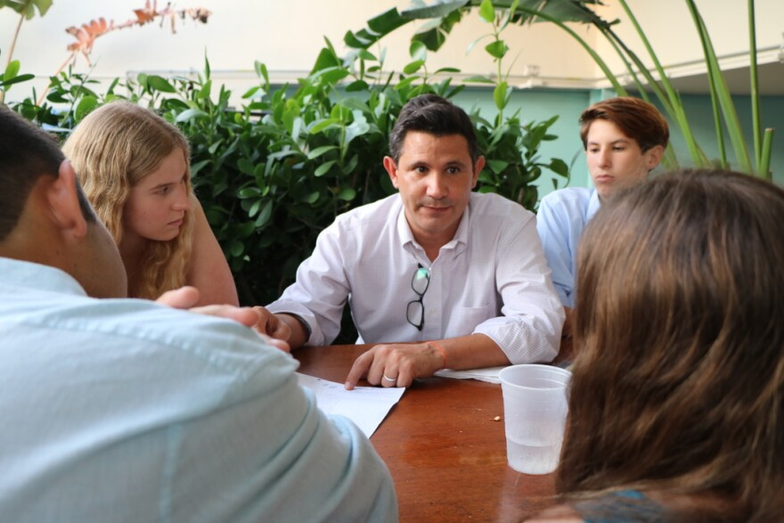 State Sen. Jason Pizzo, a Democrat from North Miami Beach, meets with three high school students about their idea for a state law allowing schools to store naloxone and staff to administer the overdose reversal drug.