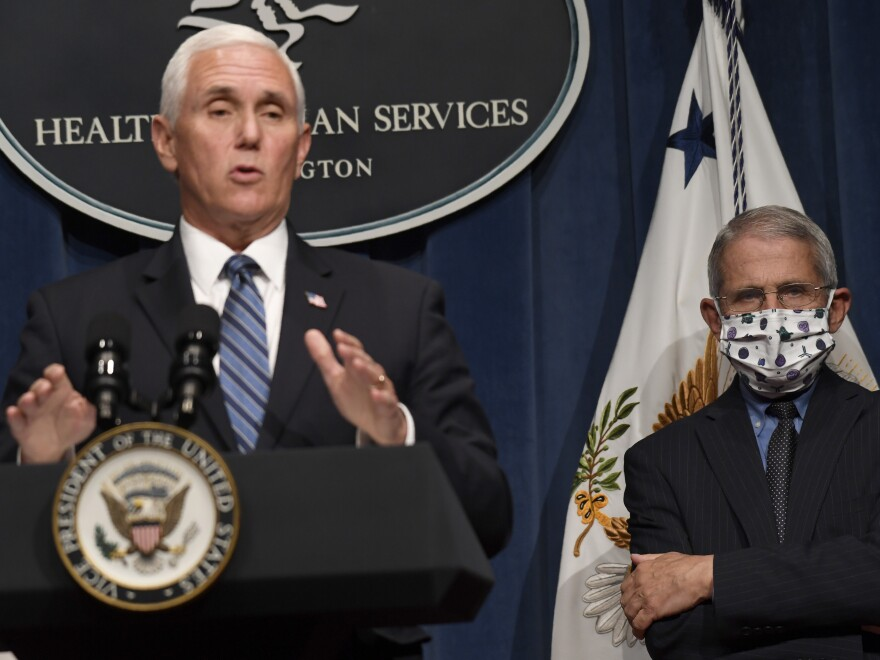 Dr. Anthony Fauci, right, director of the National Institute of Allergy and Infectious Diseases, listens as Vice President Pence speaks during a news conference Friday at the Department of Health and Human Services. The U.S. has lost more people to COVID-19 than any other country.