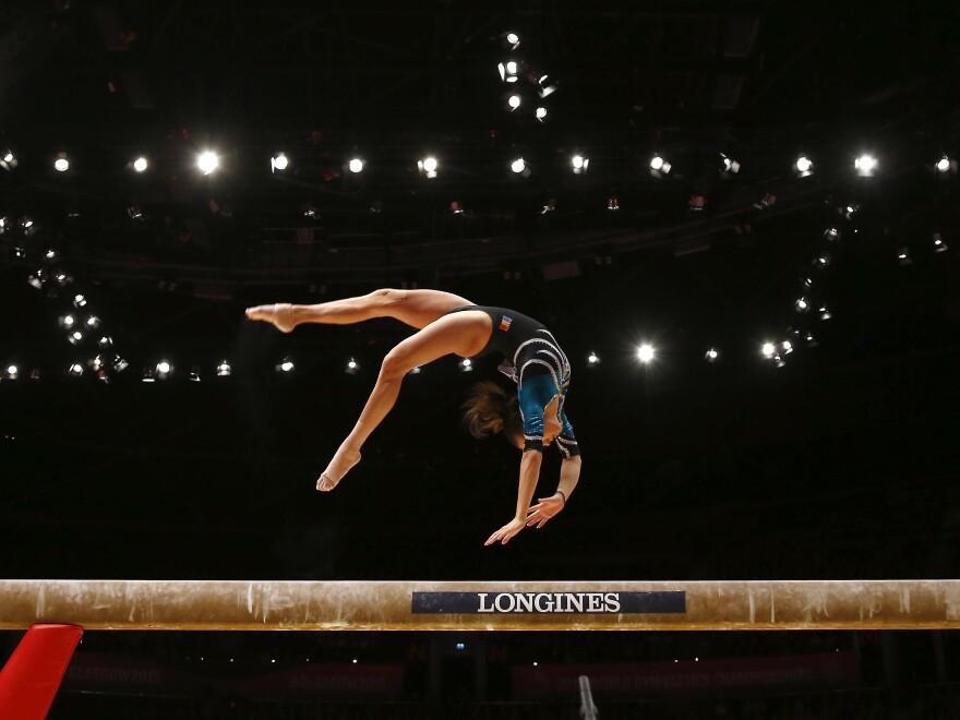 Larisa Andreea Iordache of Romania performs on the balance beam during the 2015 World Gymnastics Championships in Glasgow, Scotland.
