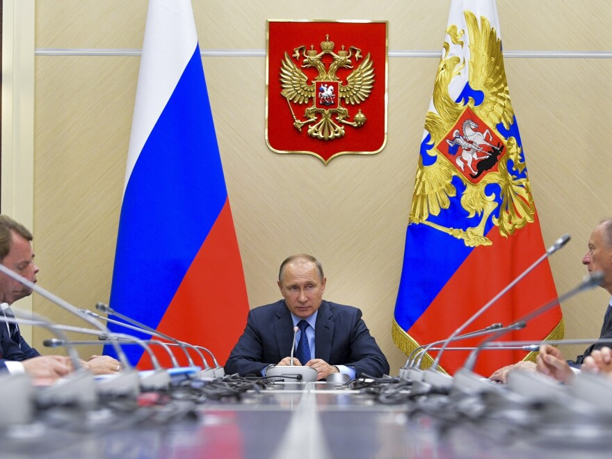 Russian President Vladimir Putin chairs a meeting of the Commission for Military Technology Cooperation outside Moscow on Thursday, ahead of Friday's G-20 meeting in Hamburg.
