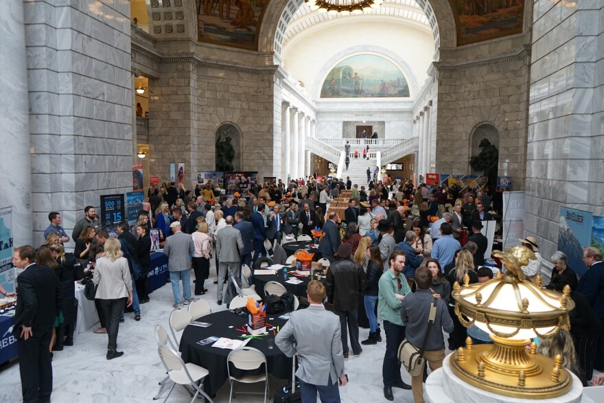 Photo of people gathered in the hall of the Utah Capitol building