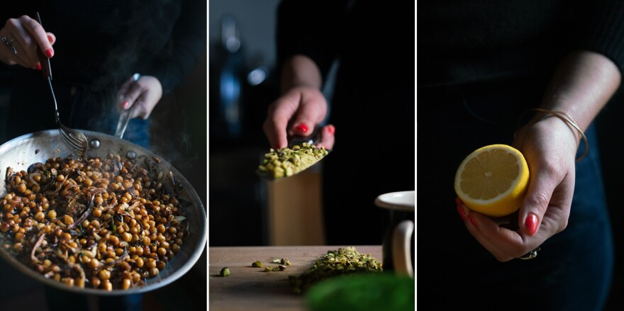 Roman stirs the chickpeas as they cook from the recipe<em> Frizzled Chickpeas and Onions with Feta and Oregano</em>, scoops chopped pistachios onto a knife, and a holds half lemon to be squeezed into yogurt.