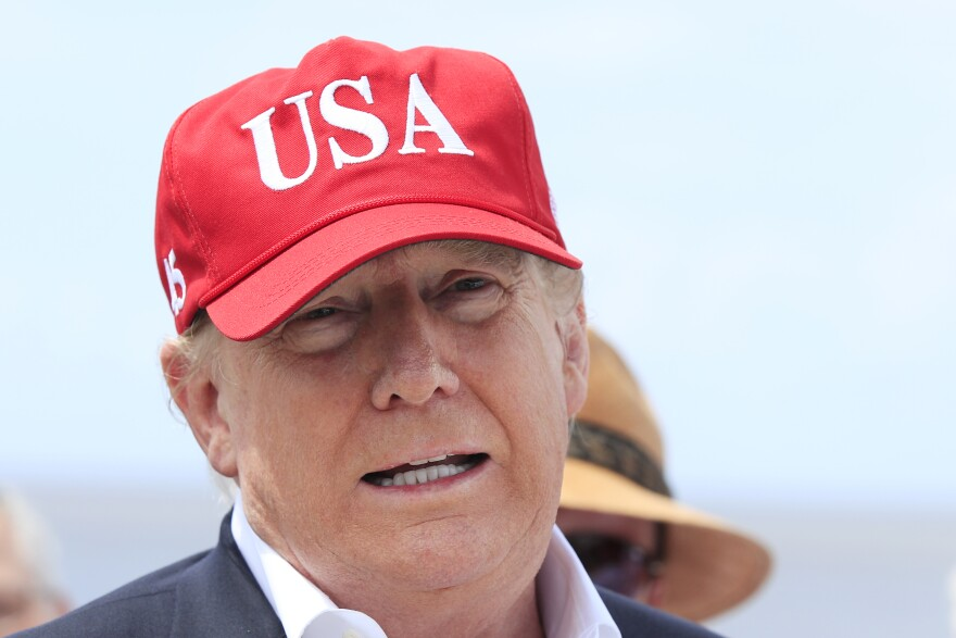 President Trump says he will close the United States' Southern border, or large sections of it, next week if Mexico does not immediately stop illegal immigration. Here Trump speaks to reporters during a visit to Lake Okeechobee and Herbert Hoover Dike at Canal Point, Fla., on Friday.