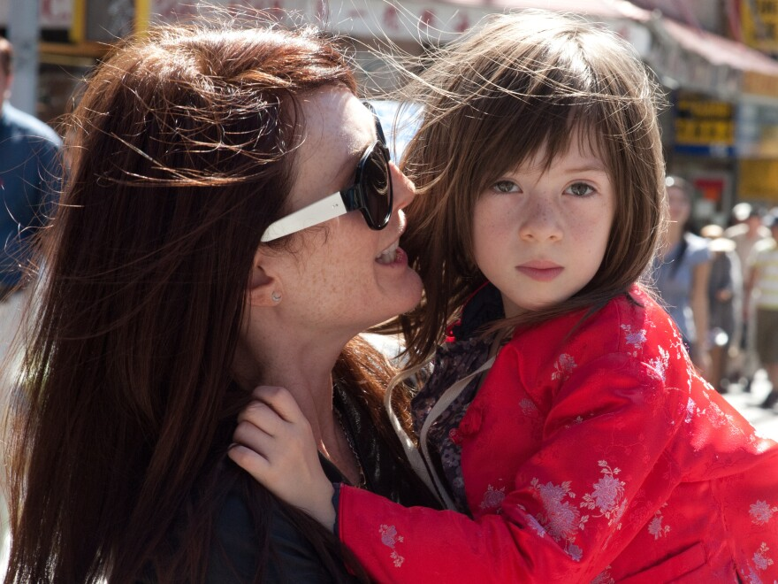 In<em> What Maisie Knew,</em> Julianne Moore plays a hard-partying rock star whose daughter, Maisie (Onata Aprile), witnesses her parents' nasty divorce.