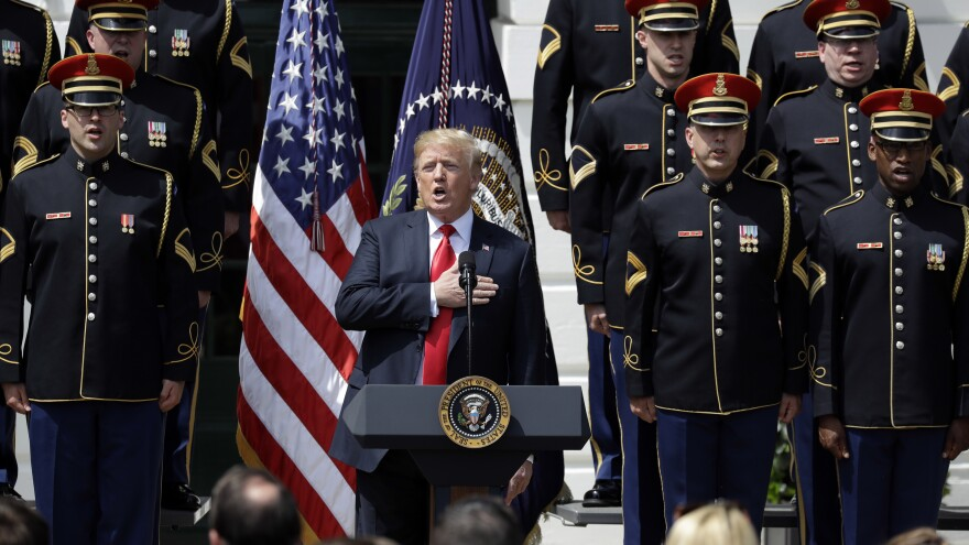 """President Trump sings during a """"Celebration of America"""" event on the South Lawn of the White House on Tuesday."""
