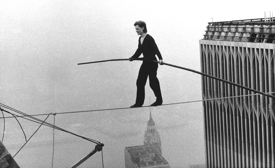Philippe Petit, a French high-wire artist, walks across a tightrope suspended between the World Trade Center towers in New York on Aug. 7, 1974.