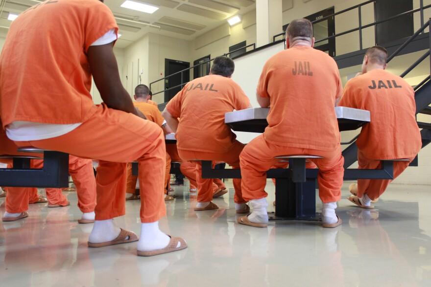 Inmate in orange jumpsuit at Sarasota County Jail