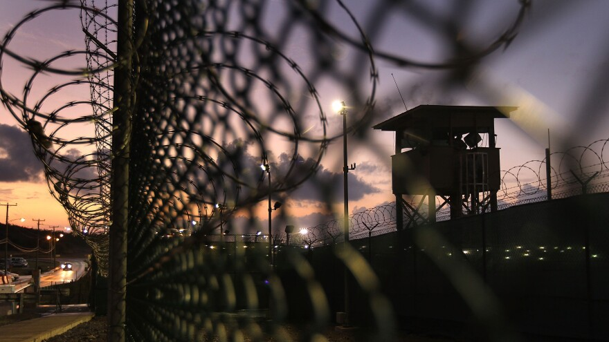 A guard tower stands at the perimeter of Camp Delta in the Guantanamo Bay detention center on March 30, 2010. On Sunday, the Pentagon announced five Yemeni detainees had been transferred to the United Arab Emirates.