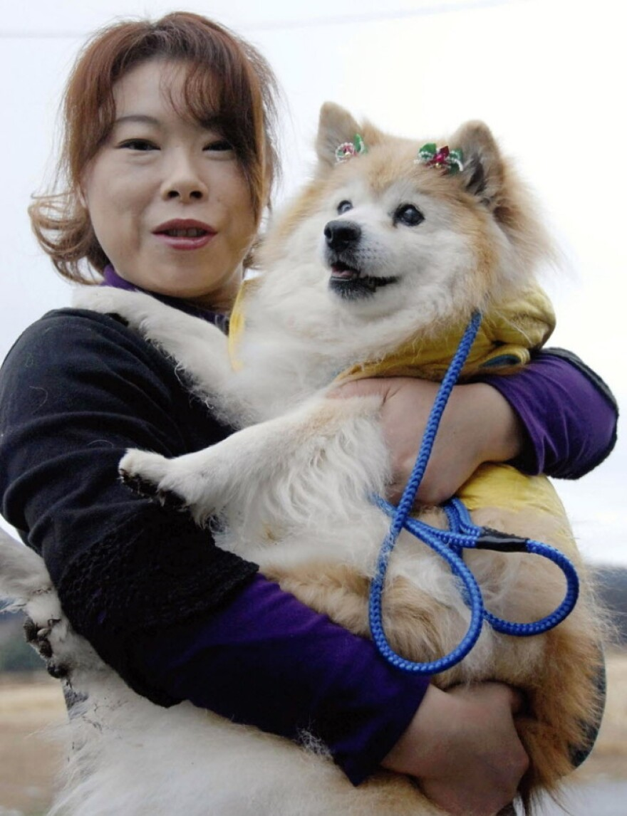 Pusuke and his human, Yumiko Shinohara, in December 2010.