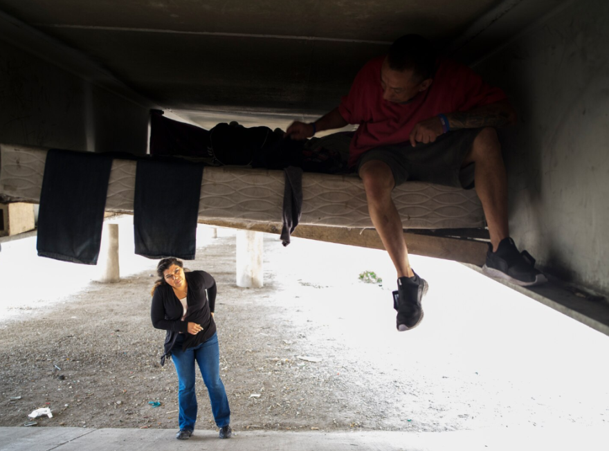 Monica Garcia, the manager of outreach at the San Antonio homeless shelter Haven For Hope, checks on a man living under an overpass in the city.
