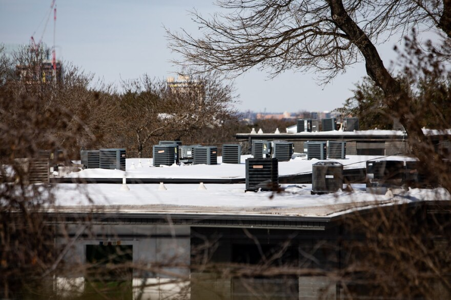 Heating and air conditioning units on the rooftop of an apartment complex in the Travis Heights neighborhood of South Austin on Tuesday.