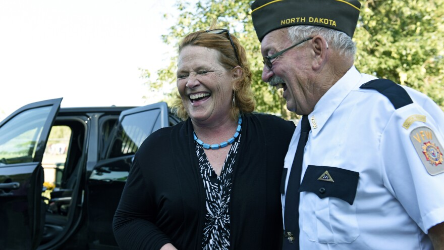 Sen. Heidi Heitkamp, D-N.D., laughs with an attendee at an event sponsored by the West Fargo Police Department on Aug. 7. Heitkamp is one of 10 Senate Democrats facing re-election in November in states President Donald Trump won in 2016.