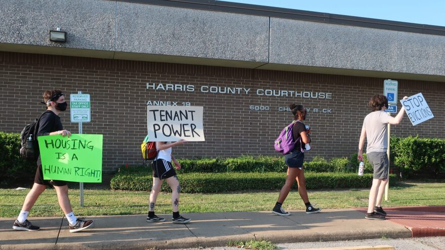 Protesters march Aug. 21 outside a courthouse in Houston, where evictions are continuing despite a moratorium ordered by the Centers for Disease Control and Prevention.