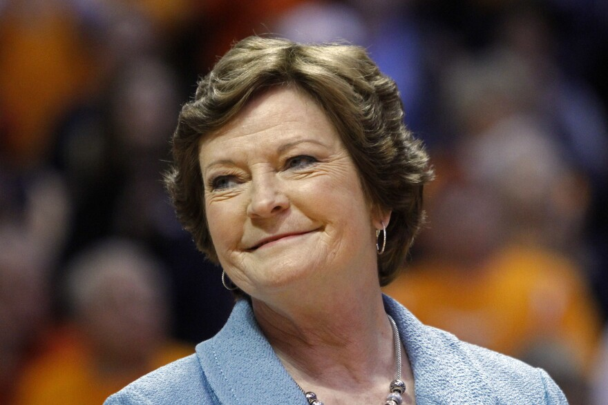 Former Tennessee women's basketball coach Pat Summitt smiles as a banner is raised in her honor before the team's game against Notre Dame in Knoxville in January 2013.