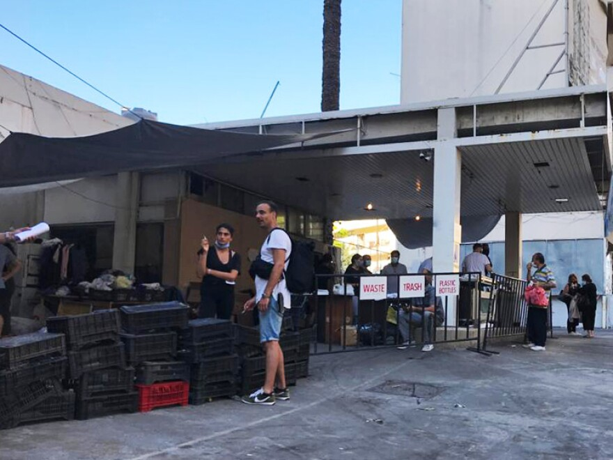 "The Nation Station distributes free produce to residents of Beirut's Geitawi neighborhood. Volunteers have wired electricity throughout the dilapidated gas station, installed WiFi and created shift schedules. ""Lebanese people have to help each other in the absence of a functioning state,"" says Nation Station cofounder Hussein Kazoun."