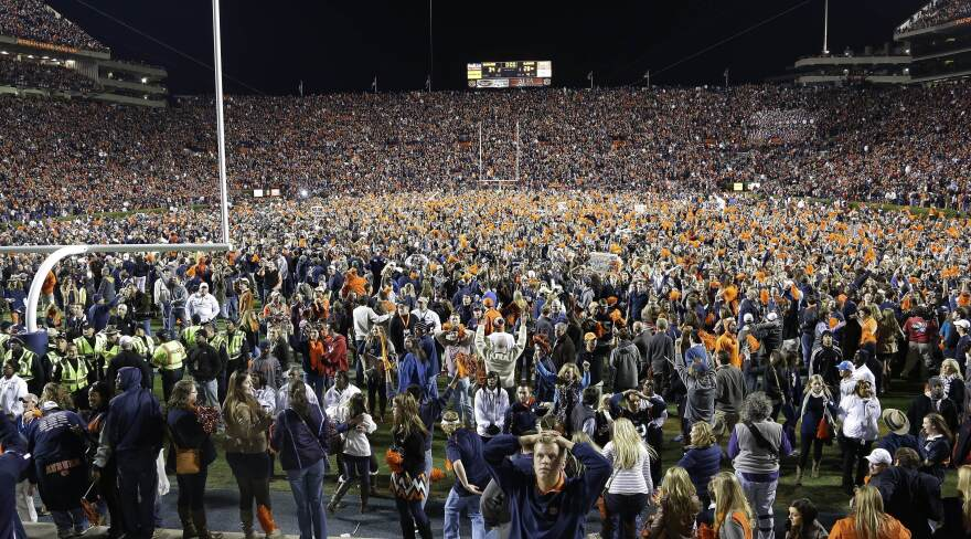 Auburn fans react at the end of a win over Alabama during the second half of an NCAA college football game in Auburn, Ala., on Saturday.