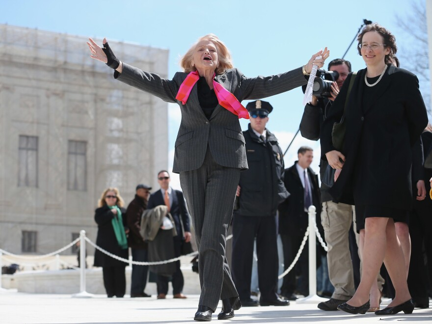Edith Windsor greets her supporters as she leaves the Supreme Court in 2013, just months before the court would rule in her favor, striking down the Defense of Marriage Act.