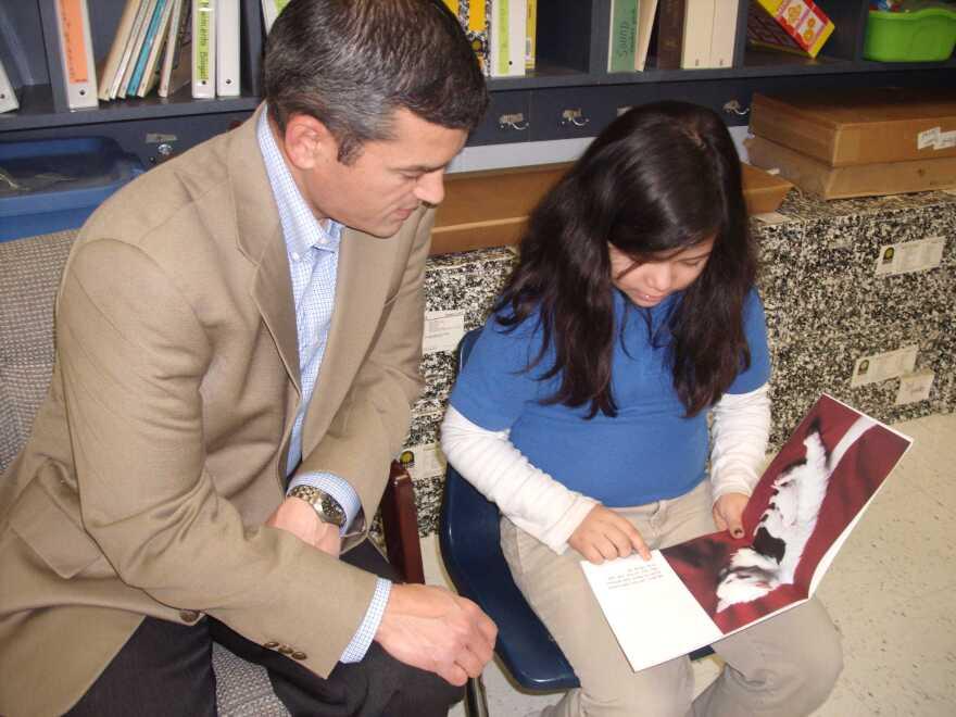 State_Rep._Mike_Villarreal_tutors_2nd_grader_at_Herff_Elem_School.JPG