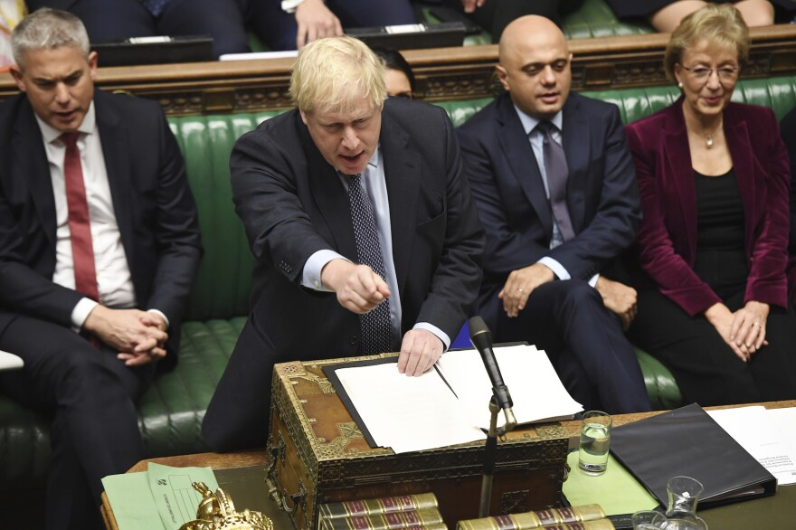 Britain's Prime Minister Boris Johnson speaks to lawmakers inside the House of Commons to update details of his new Brexit deal with EU, in London Saturday Oct. 19, 2019. (Jessica Taylor/House of Commons via AP)