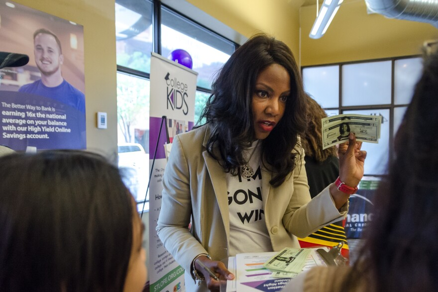 St. Louis Treasurer Tishaura Jones greets parents at a College Kids event May 21, 2019. The program, funded by city parking revenue, is being challenged in court.