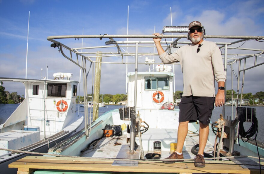 Crab fisherman Capt. Kelly Kofmehl stands on his boat