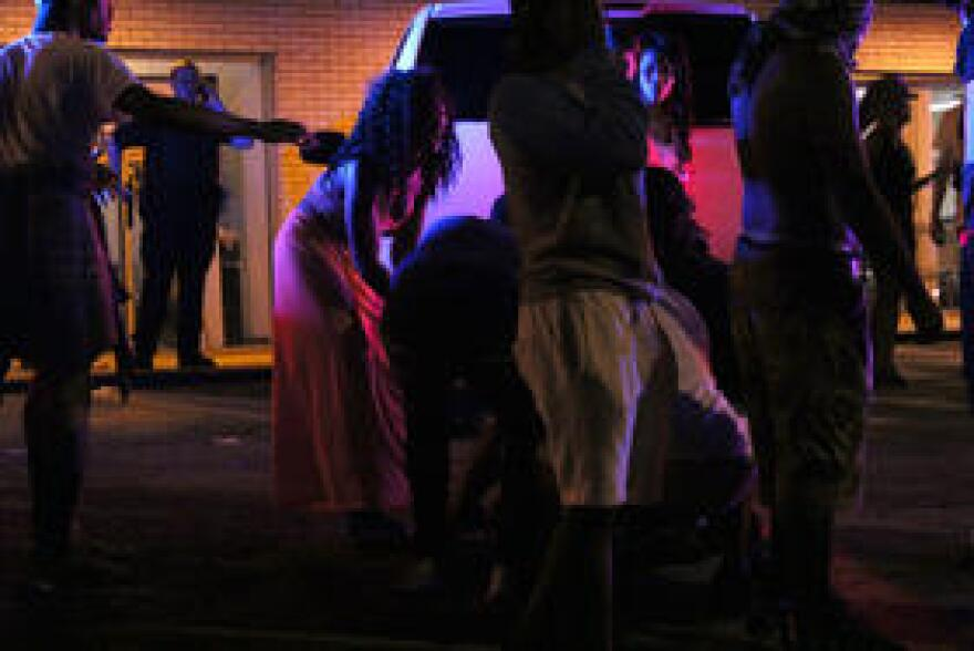 A young woman collapses in grief after hearing of the shooting victim.