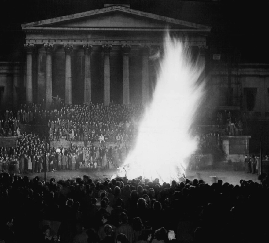 """A giant effigy of actor Danny Kaye burns during a peak moment of Guy Fawkes festivities in London, Nov. 5, 1948. Kaye was chosen as the """"Guy"""" by University students, much to the dismay of protesting Variety Artistes Federation. Kaye, cabling from Paris, said """"Would have been pleased to start fire myself."""""""