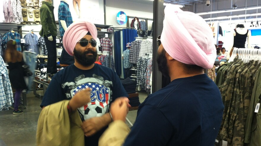 First Officer Dheeraj Singh spends most of his time at the helm of a container ship, but on a three-hour shore leave from the Port of Oakland, he visits Old Navy at Bay Street Mall in Emeryville, Calif.