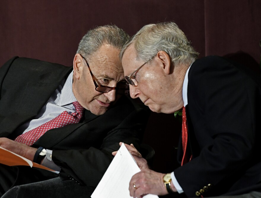 Senate Minority Leader Charles Schumer speaks to Senate Majority Leader Mitch McConnell before his 2018 speech at the McConnell Center's Distinguished Speaker Series in Louisville, Ky.