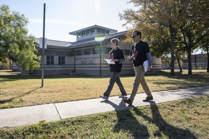 Jan Lance and Rene Lara walk down a street in Southeast Austin