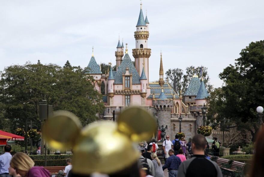 Visitors walk through Disneyland in Anaheim, California, in January 2015. (Jae C. Hong/AP)