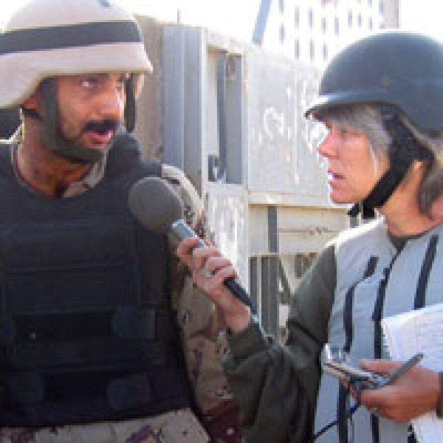 NPR correspondent Anne Garrels interviews an Iraqi soldier and interpreter during the battle of Fallujah in November 2004.