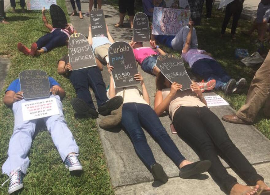 Constituents and activists rallied in support of Obamacare on Bird Rd. outside Congressman Carlos Curbelo's office as the House voted to repeal and replace it with the American Healthcare Act