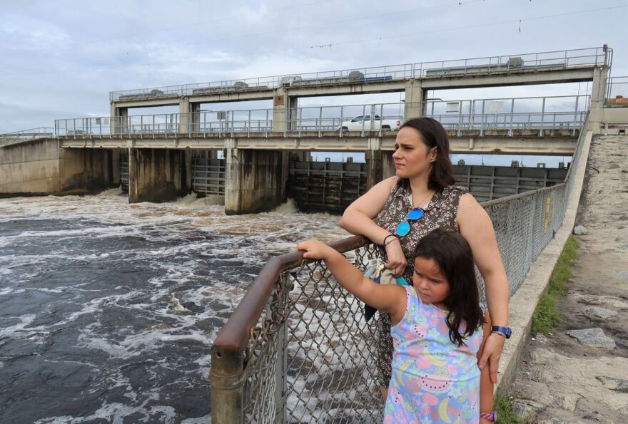 Jennifer Carr stands at Rodman Dam along the Ocklawaha River with her daughter, Carmen.