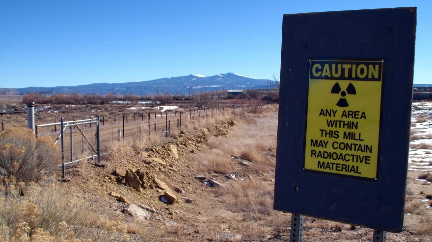 A sign at the old Kerr-McGee uranium mill site in Grants, N.M., warns of radioactive material. This week, the Justice Department announced a $5 billion settlement against the mining company to pay for the cleanup of toxic sites the company left across the U.S. over a period of more than eight decades.
