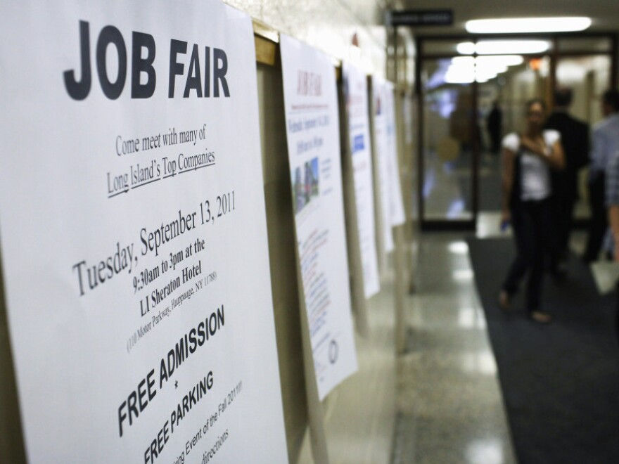 A job fair sign at the Suffolk County One Stop Employment Center last week in Hauppauge, N.Y.